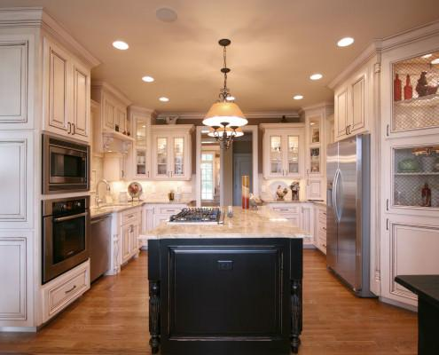 glass doors,black island,french country kitchen,stainless appliances