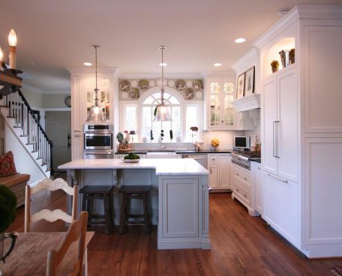 white kitchen,painted cabinets,island,mantle hood,display shelf,glass front cabinets