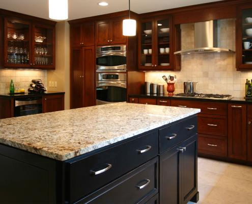 modern cabinetry,stainless hood,glass doors,contemporary design,warming drawer,island