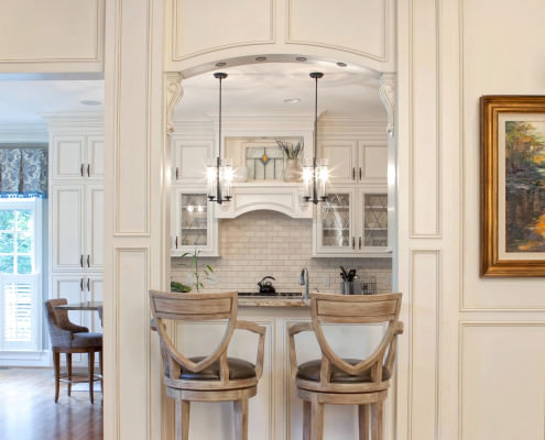 Classic Home, Classic style cabinets,wrapped columns,leaded glass,wainscoting,Classic kitchen,seating area,kitchen
